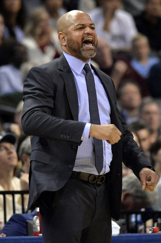 Memphis Grizzlies coach J.B. Bickerstaff calls to players during the second half of an NBA basketball game against the Cleveland Cavaliers on Wednesday, Dec. (AP Photo/Brandon Dill)