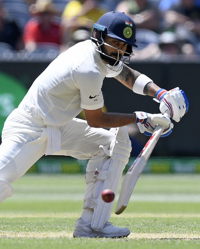 India's Virat Kohli bats during play on day two of the third cricket test between India and Australia in Melbourne, Australia, Thursday, Dec. (AP Photo/Andy Brownbill)