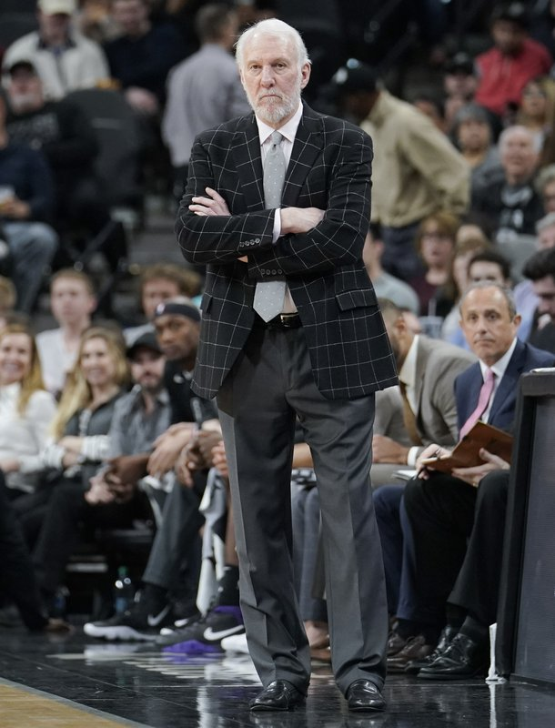 San Antonio Spurs coach Gregg Popovich watches play during the second half of the team's NBA basketball game against the Denver Nuggets, Wednesday, Dec. (AP Photo/Darren Abate)