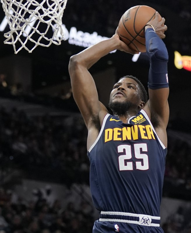 Denver Nuggets' Malik Beasley dunks during the first half of an NBA basketball game against the San Antonio Spurs, Wednesday, Dec. (AP Photo/Darren Abate)