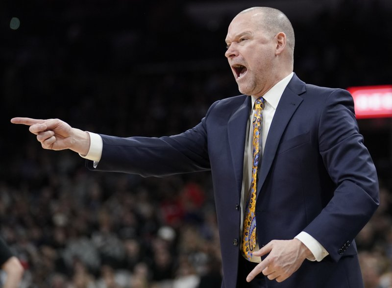 Denver Nuggets coach Michael Malone yells to his players during the second half of the team's NBA basketball game against the San Antonio Spurs, Wednesday, Dec. (AP Photo/Darren Abate)