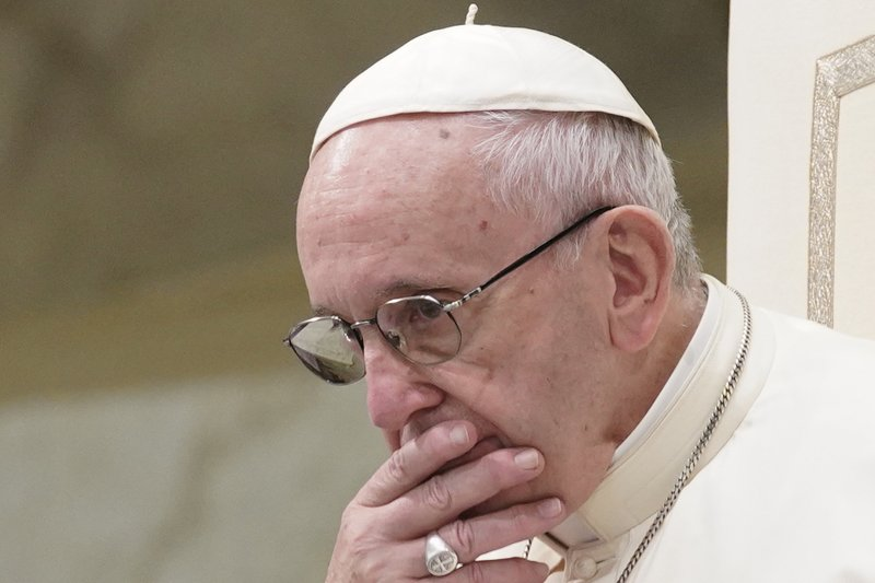 FILE - In this Aug. 22, 2018 file photo, Pope Francis appears during his weekly general audience in the Pope Paul VI hall, at the Vatican. (AP Photo/Andrew Medichini, File)