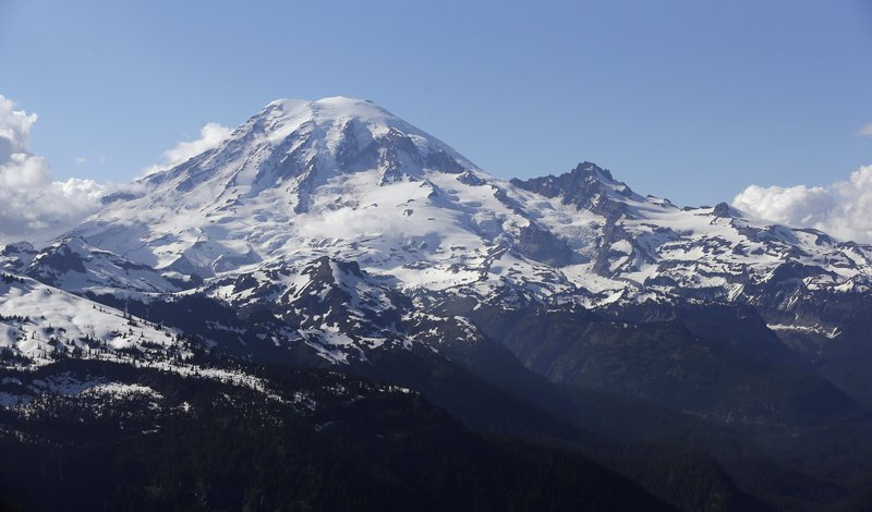 FILE - In this file photo taken June 19, 2013, Mount Rainier is seen from a helicopter flying south of the mountain and west of Yakima, Wash. (AP Photo/Elaine Thompson, File)