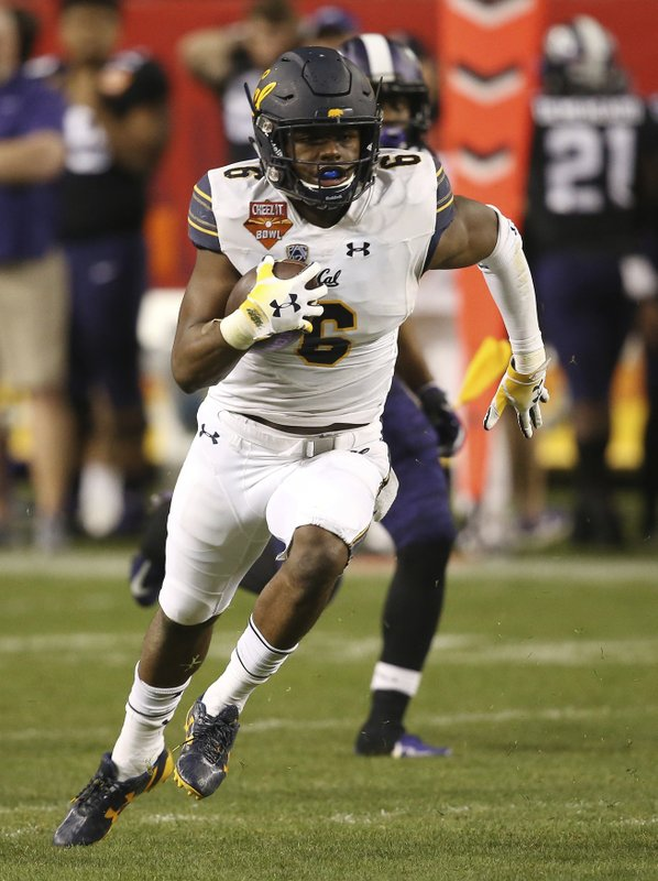 California safety Jaylinn Hawkins runs with the ball after intercepting a TCU pass during the first half of the Cheez-It Bowl NCAA college football game Wednesday, Dec. (AP Photo/Ross D. Franklin)