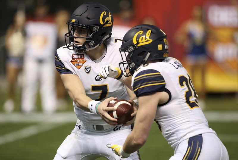 California quarterback Chase Garbers (7) hands the ball off to running back Patrick Laird (28) during the first half of the Cheez-It Bowl NCAA college football game against TCU on Wednesday, Dec. (AP Photo/Ross D. Franklin)