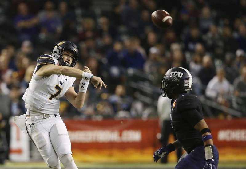 California quarterback Chase Garbers (7) throws a pass over TCU linebacker Arico Evans, right, during the first half of the Cheez-It Bowl NCAA college football game Wednesday, Dec. (AP Photo/Ross D. Franklin)