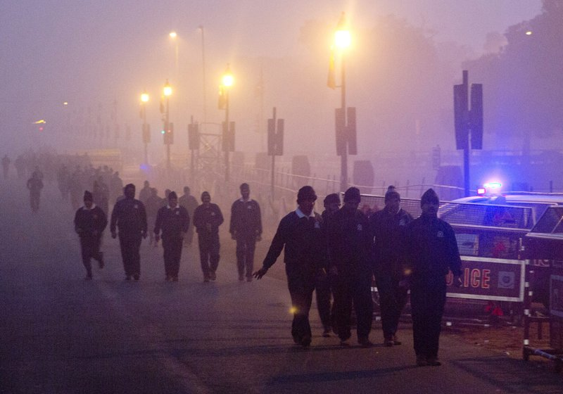 In this Wednesday, Dec. 26, 2018, photo, Indian military personals walk amidst morning smog in New Delhi, India. (AP Photo/Manish Swarup)