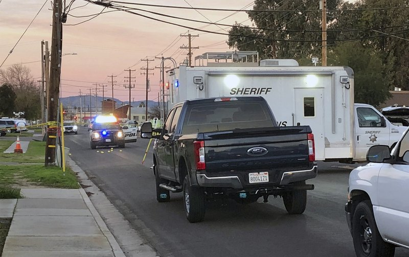 Police investigate the scene of a shooting that took the life of Newman Police Officer Ronil Singh, 33, on Wednesday, Dec. (Deke Farrow/The Modesto Bee via AP)