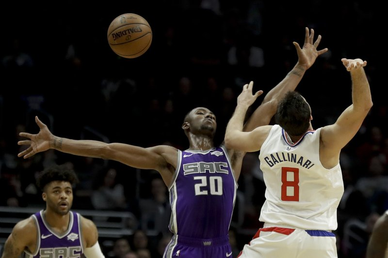 Sacramento Kings forward Harry Giles (20) blocks a shot by Los Angeles Clippers forward Danilo Gallinari during the second half of an NBA basketball game in Los Angeles, Wednesday, Dec. (AP Photo/Chris Carlson)