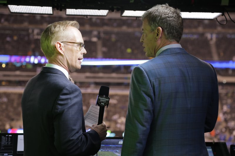 FILE - This Oct. 11, 2018, file photo shows Troy Aikman, right, and Joe Buck working before an NFL football game between the New York Giants and the Philadelphia Eagles  in East Rutherford, N. (AP Photo/Frank Franklin II, File)