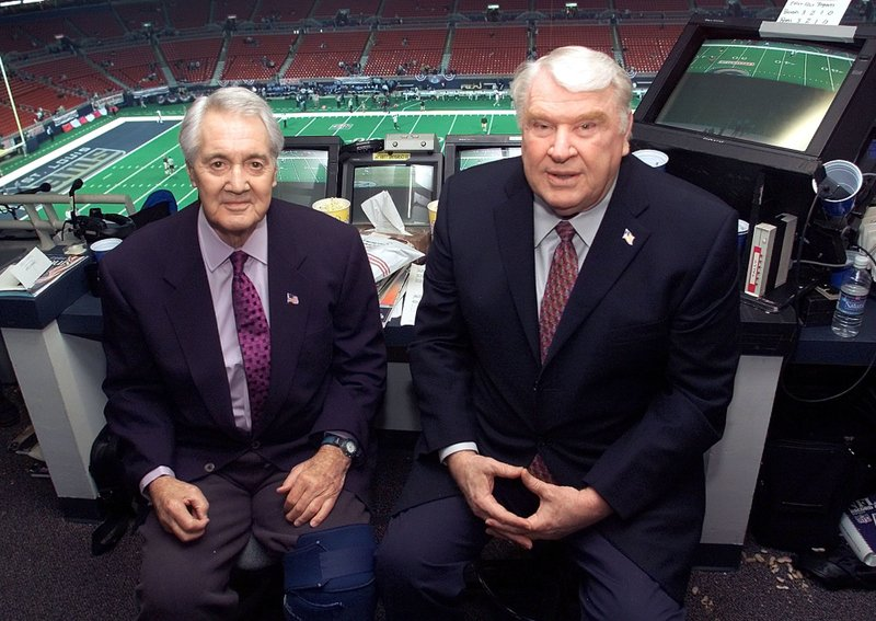 FILE - This Jan. 20, 2002, file photo shows Pat Summerall, left,  and John Madden, right, in the FOX broadcast booth before the NFC divisional playoff in St. (AP Photo/Michael Conroy, File)