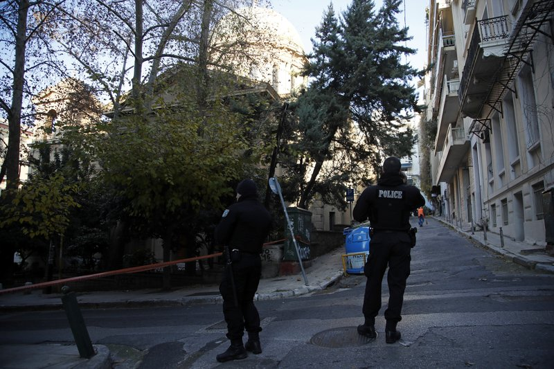 Police guard after an explosion outside the Orthodox church of Agios Dionysios in the upscale Kolonaki area of Athens, Thursday, Dec. (AP Photo/Thanassis Stavrakis)