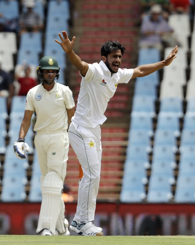 Pakistan's bowler Hasan Ali, right, successfully appeals for LBW against South Africa's batsman Keshav Maharaj on day two of the first cricket test match between South Africa and Pakistan at Centurion Park in Pretoria, South Africa, Thursday, Dec. (AP Photo/Themba Hadebe)