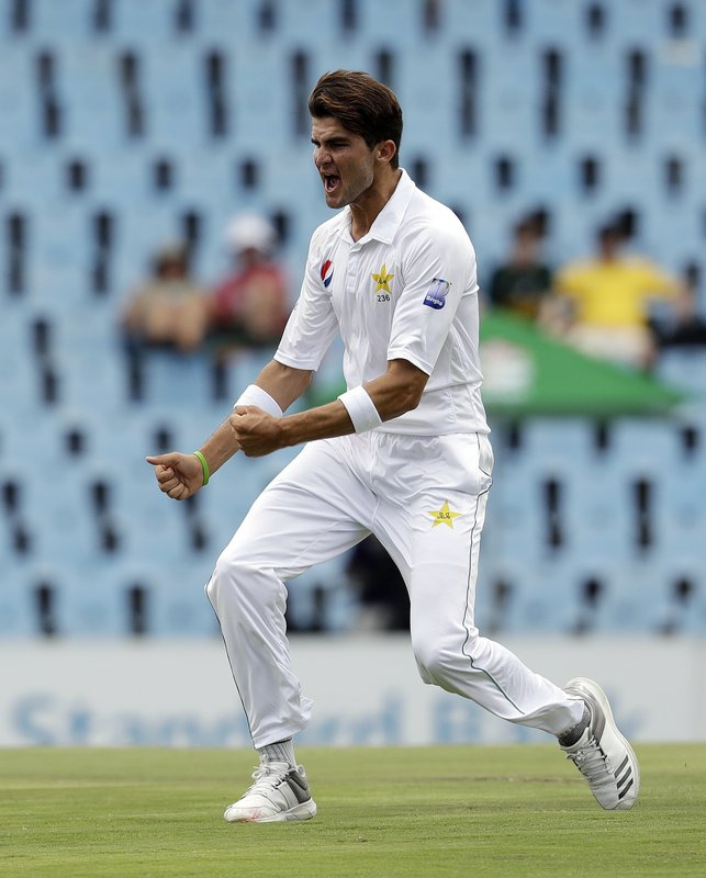 Pakistan's bowler Shaheen Afridi celebrates after dismissing South Africa's batsman Temba Bavuma for 53 runs on day two of the first cricket test match between South Africa and Pakistan at Centurion Park in Pretoria, South Africa, Thursday, Dec. (AP Photo/Themba Hadebe)