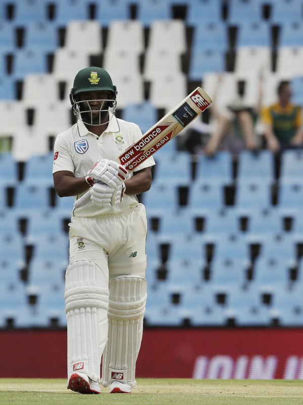 South Africa's batsman Temba Bavuma raises his bat after reaching half-century on day two of the first cricket test match between South Africa and Pakistan at Centurion Park in Pretoria, South Africa, Thursday, Dec. (AP Photo/Themba Hadebe)