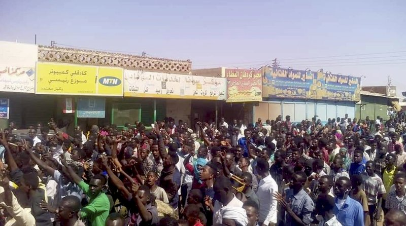In this Tuesday, Dec. 25, 2018 handout image provided a Sudanese activist, people chant slogans during a demonstration in Kordofan, Sudan. (Sudanese Activist via AP)