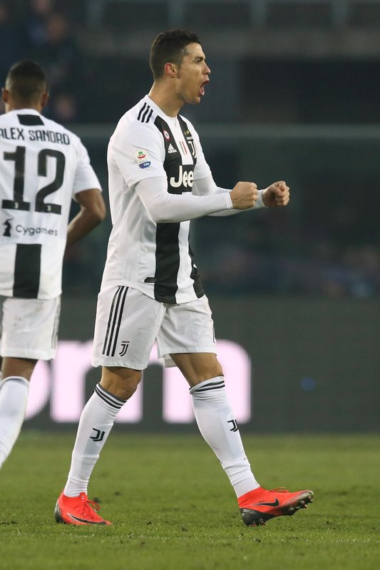 FILE - In this Wednesday,  Dec. 26, 2018 file photo, Juventus' Cristiano Ronaldo celebrates after scoring his side's second goal during the Serie A soccer match between Atalanta and Juventus in Bergamo, Italy. (Paolo Magni/ANSA via AP)