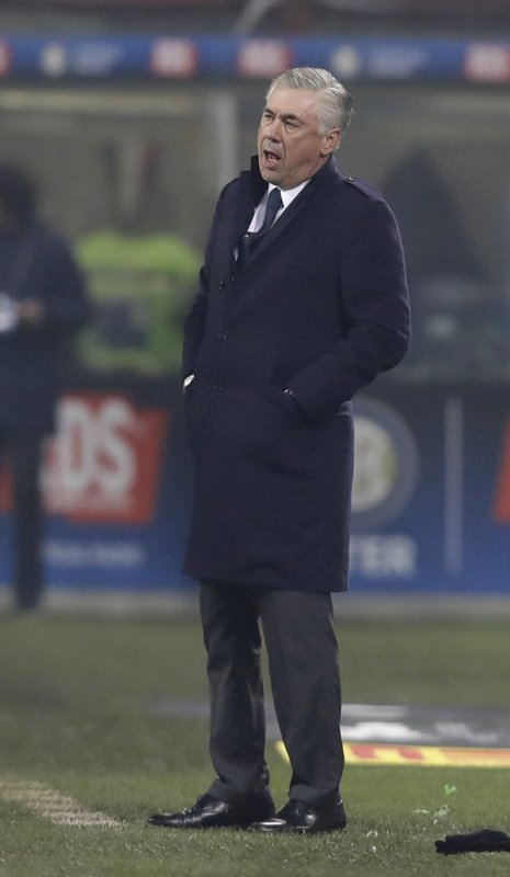 Napoli coach Carlo Ancelotti stands during a Serie A soccer match between Inter Milan and Napoli, at the San Siro stadium in Milan, Italy, Wednesday, Dec. (AP Photo/Luca Bruno)