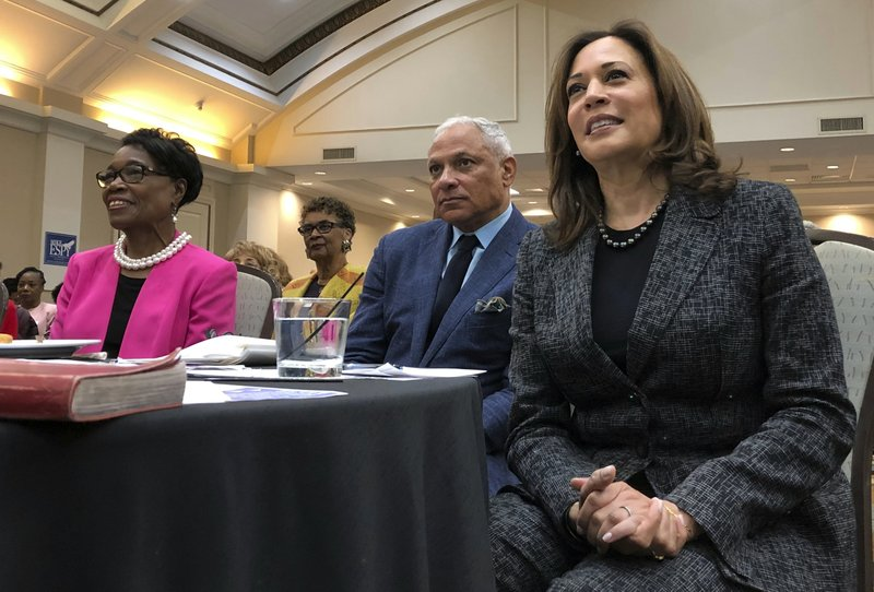 FILE - In this Nov. 17, 2018, file photo, Sen. Kamala Harris, a California Democrat, and possible 2020 presidential candidate, and then Mississippi Democratic Senate candidate Mike Espy, attend an event in Jackson, Miss. (AP Photo/Jeff Amy, File)