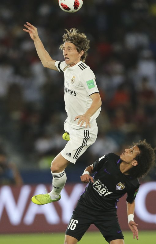 Real Madrid's Luka Modric heads the ball above Emirates's Al Ain Mohamed Abdulrahman during the Club World Cup final soccer match between Real Madrid and Al Ain at Zayed Sport City in Abu Dhabi, United Arab Emirates, Saturday, Dec. (AP Photo/Kamran Jebreili)