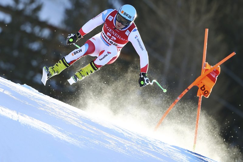 Switzerland's Patrick Kueng speeds down the course during a ski World Cup Men's Downhill training in Bormio, Italy, Thursday, Dec. (AP Photo/Marco Trovati)