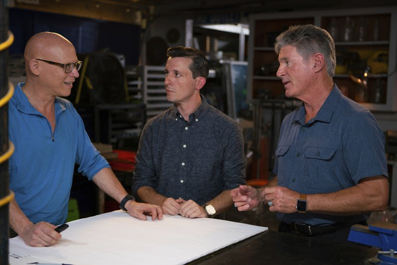 In this October 2018 frame from video provided the Science Channel, from left, Stunt builder Steve Wolf, magician Lee Terbosic and George Hardeen, great-nephew of Harry Houdini, talk in the first episode of