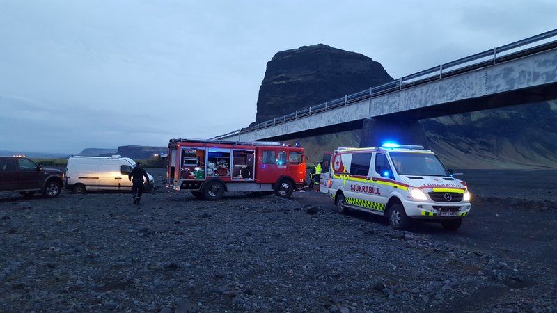 In this UGC photo provided by Tour guide Adolf Erlingsson  on Thursday, Dec. 27, 2018 , emergency services at the scene of a crash, in Skeidararsandur, Iceland. (Adolf Erlingsson via AP)