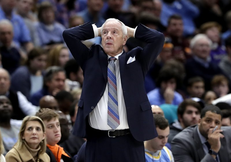 File-This Dec. 22, 2018, file photo shows North Carolina head coach Roy Williams watching his team during the second half of an NCAA college basketball game against Kentucky in the fifth annual CBS Sports Classic, in Chicago. (AP Photo/Nam Y. Huh, File)