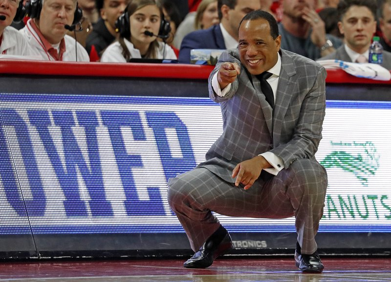 File-This Jan. 21, 2018, file photo shows North Carolina State head coach Kevin Keatts instructing  his team from the sidelines during the first half of an NCAA college basketball game against Miami in Raleigh, N. (AP Photo/Karl B DeBlaker, File)