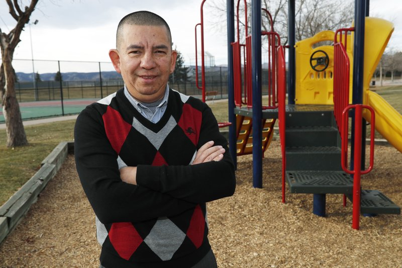 FILE - In this, Dec. 15, 2018, file photo, Pedro H. Gonzalez, the bi-vocational Denver pastor and board member of Colorado Family Action, poses for a photograph in Clement Park in Littleton, Colo. (AP Photo/David Zalubowski, File)