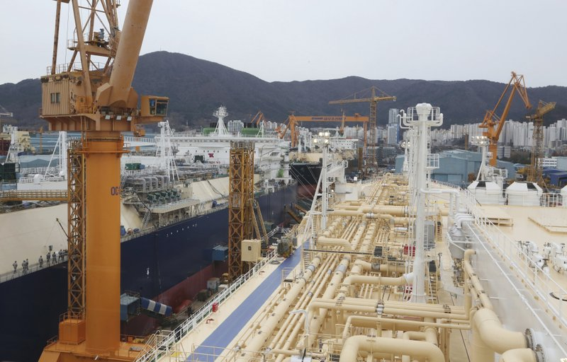 In this Friday, Dec. 7, 2018 photo, liquefied natural gas (LNG) carriers are being constructed at the Daewoo Shipbuilding and Marine Engineering facility in Geoje Island, South Korea. (AP Photo/Ahn Young-joon)