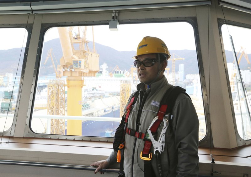 In this Friday, Dec. 7, 2018 photo, Song Ha-dong, a senior official from Daewoo Shipbuilding and Marine Engineering, speaks during an interview on the building of a large-sized liquefied natural gas (LNG) carrier at the Daewoo Shipbuilding and Marine Engineering facility in Geoje Island, South Korea. (AP Photo/Ahn Young-joon)