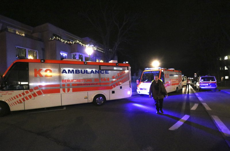 Ambulances stand outside a church in Vienna, Austria, Thursday, Dec. 27, 2018. First police reports indicated an armed robbery. (AP Photo/Ronald Zak)