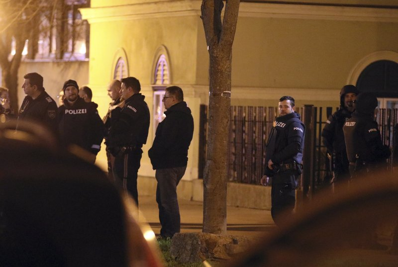 Special police stand outside a church in Vienna, Austria, Thursday, Dec. 27, 2018. First police reports indicated an armed robbery. (AP Photo/Ronald Zak)