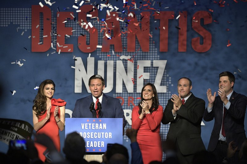 FILE - In this Nov. 6, 2018, file photo, Florida Gov.-elect Ron DeSantis, second from left, thanks supporters with his wife, Casey, left, Lt. (AP Photo/Phelan M. Ebenhack, File)