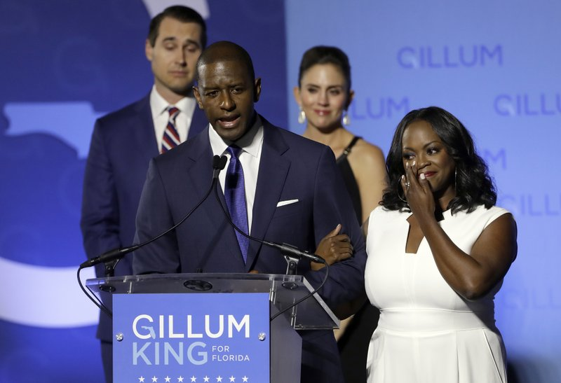 FILE - In this Nov. 6, 2018, file photo, Florida Democratic gubernatorial candidate Andrew Gillum gives his concession speech as he is joined on stage by his wife R. (AP Photo/Chris O'Meara, File)
