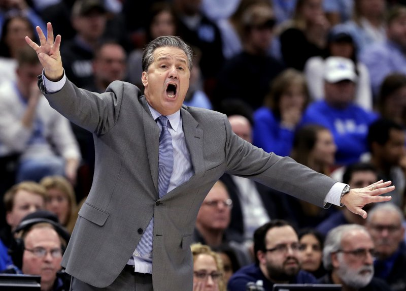 FILE - In this Dec. 22, 2018, file photo, Kentucky head coach John Calipari directs his team against North Carolina during the second half of an NCAA college basketball game in the fifth annual CBS Sports Classic in Chicago. (AP Photo/Nam Y. Huh, File)