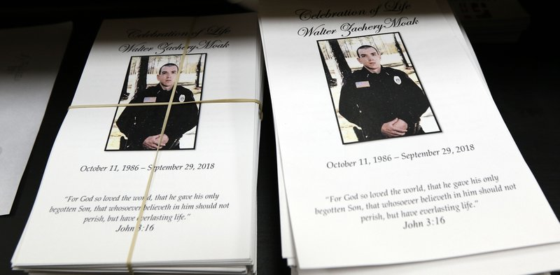 FILE - In this Oct. 4, 2018, file photo, funeral programs for Corporal Zach Moak await distribution at his funeral services in Brookhaven, Miss. (AP Photo/Rogelio V. Solis, File)