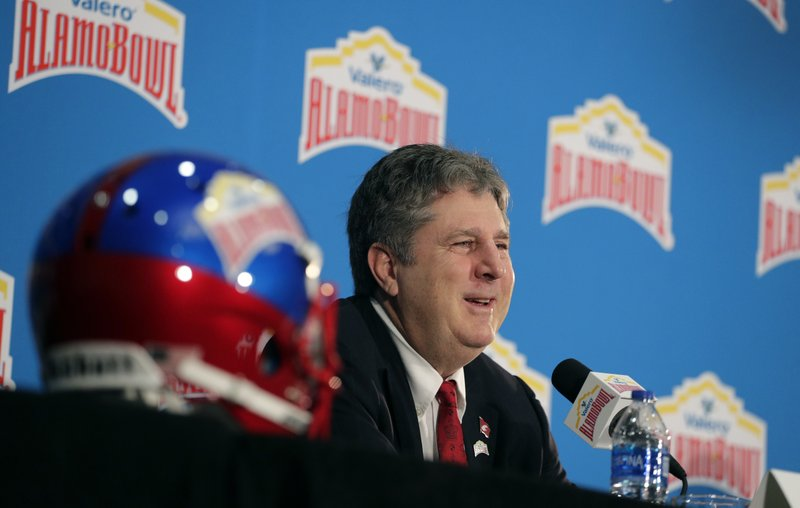Washington State head coach Mike Leach answers a question during a news conference, Thursday, Dec. 27, 2018, in San Antonio. (AP Photo/Eric Gay)