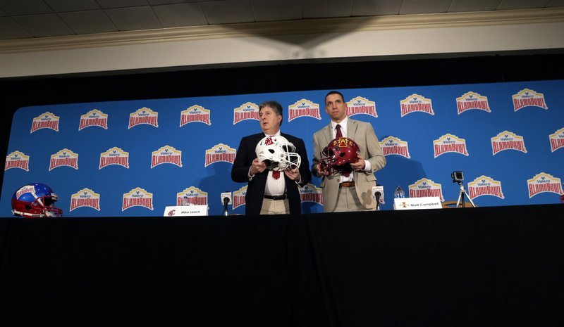 Washington State head coach Mike Leach, left, and Iowa State head coach Matt Campbell, right, pose for a photo following a news conference, Thursday, Dec. (AP Photo/Eric Gay)