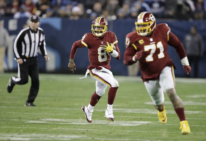 FILE - In this Dec. 22, 2018, file photo, Washington Redskins quarterback Josh Johnson (8) scrambles behind offensive tackle Trent Williams (71) during the second half of the team's NFL football game against the Tennessee Titans in Nashville, Tenn. (AP Photo/James Kenney, File)