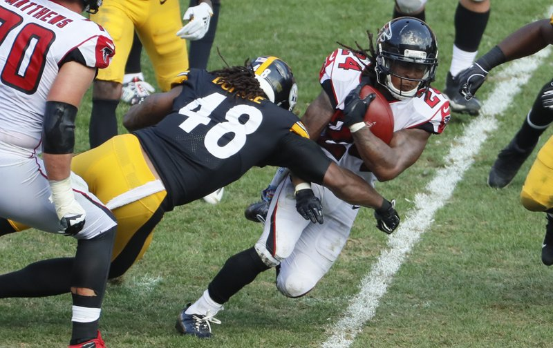 File-This Oct. 7, 2018, file photo shows Atlanta Falcons running back Devonta Freeman (24) playing against the Pittsburgh Steelers during an NFL football game, in Pittsburgh. (AP Photo/Gene J. Puskar, File)