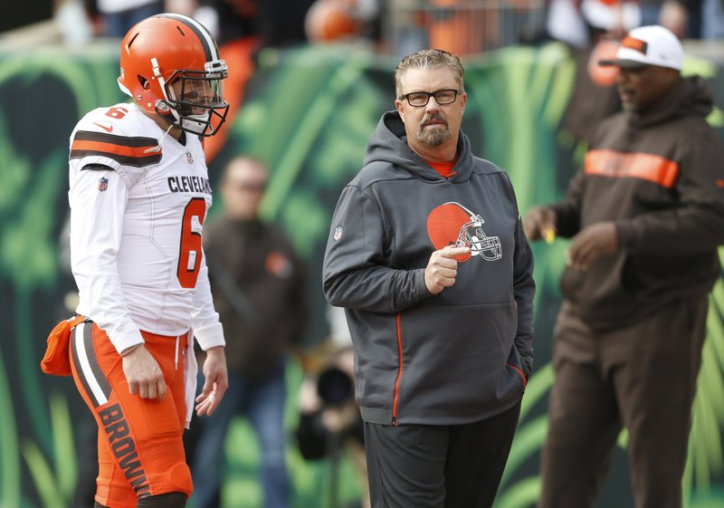 FILE - In this Nov. 25, 2018, file photo, Cleveland Browns quarterback Baker Mayfield (6) and coach Gregg Williams meet on the field before the team's NFL football game against the Cincinnati Bengals in Cincinnati. (AP Photo/Gary Landers, File)