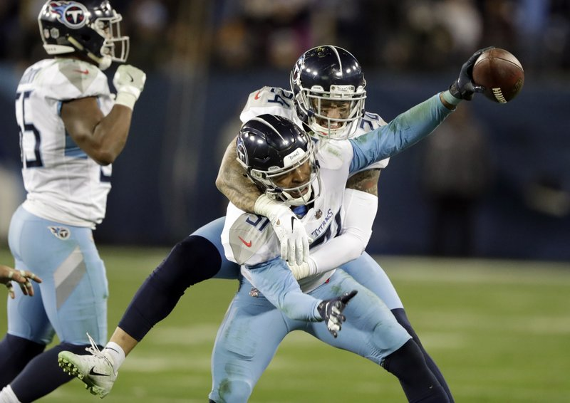 File-This Dec. 22, 2018, file photo shows Tennessee Titans free safety Kevin Byard (31) celebrating with Kenny Vaccaro (24) after Byard intercepted a pass against the Washington Redskins late in the fourth quarter of an NFL football game in Nashville, Tenn. (AP Photo/James Kenney, File)