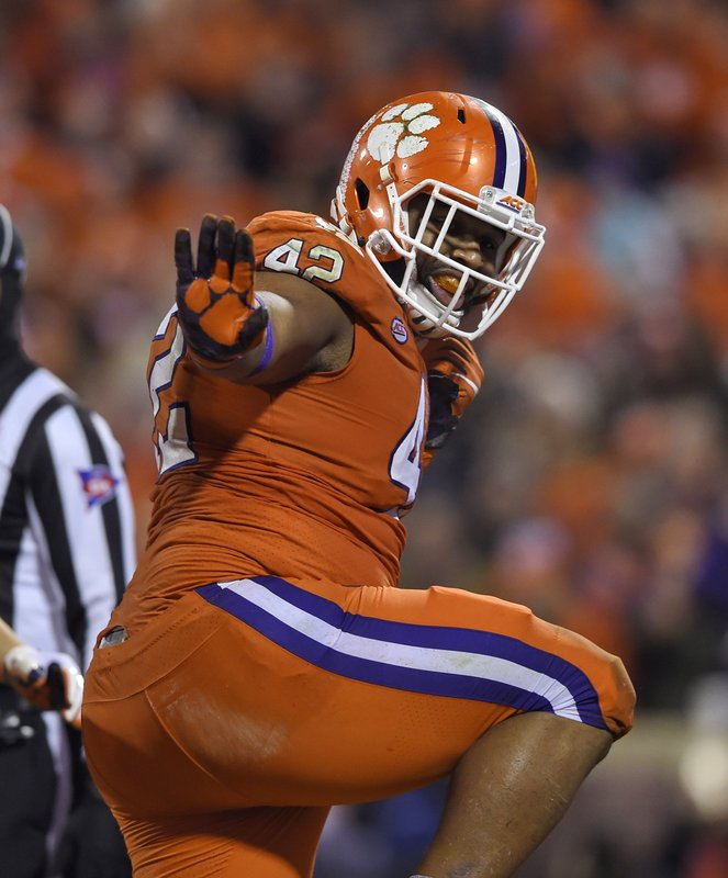 File-This Nov. 24, 2018, file photo shows Clemson's Christian Wilkins doing the Heisman pose after scoring a touchdown during the first half of an NCAA college football game against South Carolina, in Clemson, S. (AP Photo/Richard Shiro, File)