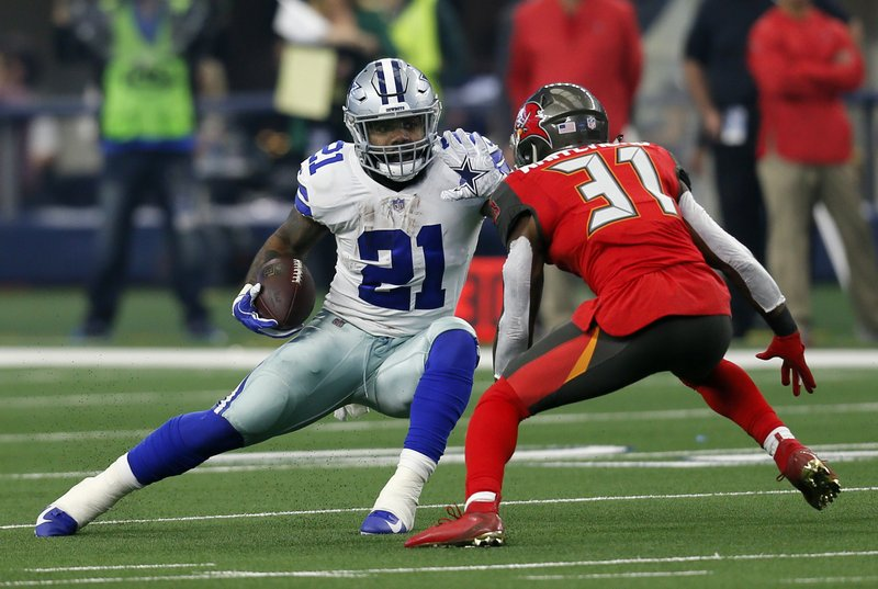 File-This Dec. 23, 2018, file photo shows Dallas Cowboys running back Ezekiel Elliott (21) attempting to evade a tackle by Tampa Bay Buccaneers safety Jordan Whitehead (31) after Elliott caught a pass in the first half time of an NFL football game in Arlington, Texas. (AP Photo/Roger Steinman, File)