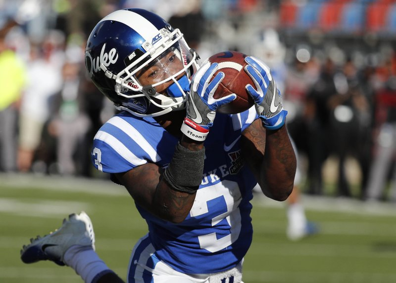 Duke wide receiver T.J. Rahming (3) hauls in a touchdown pass reception against Temple during the first half of the Independence Bowl, an NCAA college football game in Shreveport, La. (AP Photo/Rogelio V. Solis)