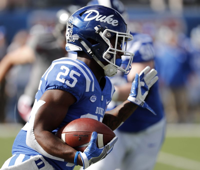 Duke running back Deon Jackson (25) runs upfield for a first down against Temple during the first half of the Independence Bowl, an NCAA college football game in Shreveport, La. (AP Photo/Rogelio V. Solis)