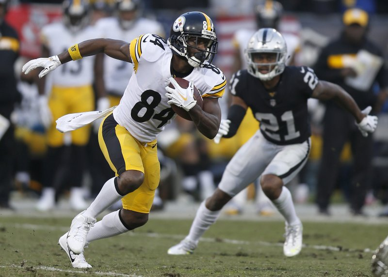 File-This Dec. 9, 218, file photo shows Pittsburgh Steelers wide receiver Antonio Brown (84) running against Oakland Raiders cornerback Gareon Conley (21) during the second half of an NFL football game in Oakland, Calif. (AP Photo/D. Ross Cameron, File)