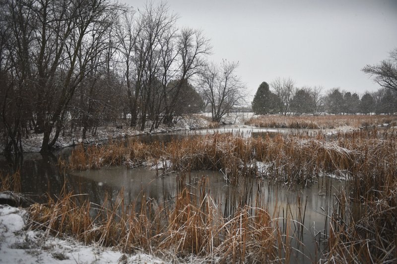 Snow falls at Sertoma Park on Thursday, Dec. 27, 2018, in Sioux Falls, S.D. The weather service in Sioux Falls, South Dakota says rain is changing over to snow from west to east Thursday with heavy snow and gusty winds through Friday. (Briana Sanchez/The Argus Leader via AP)